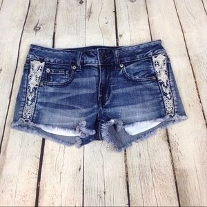 AEO Shortie fringed denim shorts with lace
